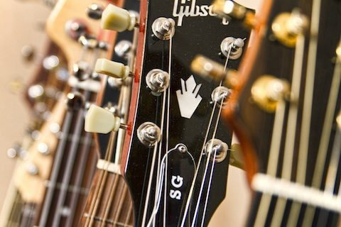 Cliff Smith Guitar Lessons London- close up of Cliff Smith's guitar rack, focus on Gibson SG Standard headstock.